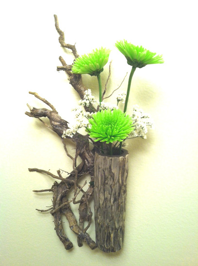 A PotterJohn Ikebana Relief Flower Arrangement