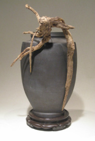 urn type ikebana container with sharp root