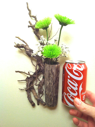 Ikebana relief flower arrangement and coke can for comparrison